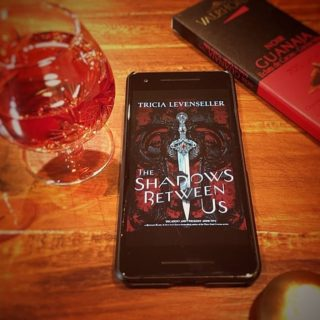 It's a wine and chocolate kinda holiday Easter Monday. Just finished The Shadows Between Us by @tricialevenseller. It was pretty predictable as far as plots go, but I did like the author's take on female sexuality. It's a light fun read with not a ton of world building to bog the pace down. The magic elements were subtle and worked. It was a YA fantasy that read like a romance. Only real issue was that the love scene could have used a bit more heat (but I assume that was done because it is a YA) I would recommend this if you want to read fantasy with a strong romantic plot that doesn't take itself too seriously.  #book #bookaddict #bookish #booklove #booklover #booknerd #books #booksofinstagram #bookstagram #bookstagrammer #bookworm #fiction #reader #readersofinstagram #reading #amreading #yafiction #ya #fantasy #yafantasy
